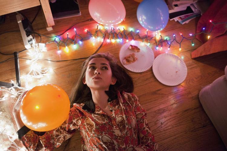 Young woman looking at balloons