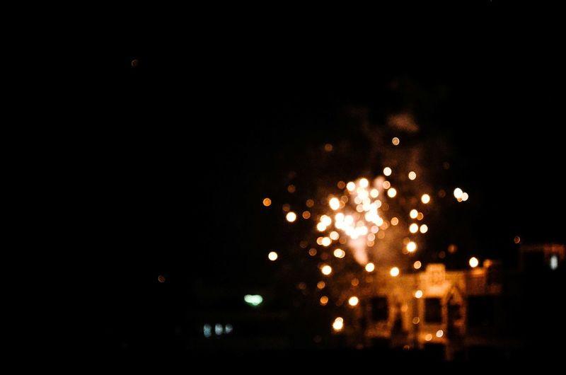 Exploding Illuminated Night Firework - Man Made Object No People Outdoors City Sky Celebration