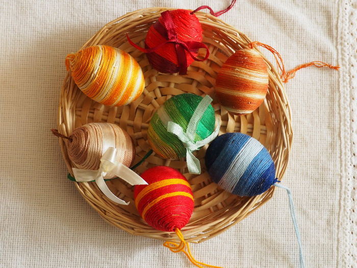 Close-Up Of Easter Eggs Wrapped In Threads