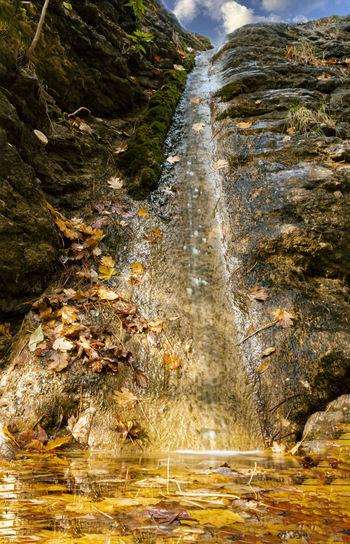 Close-up of stream flowing through rocks