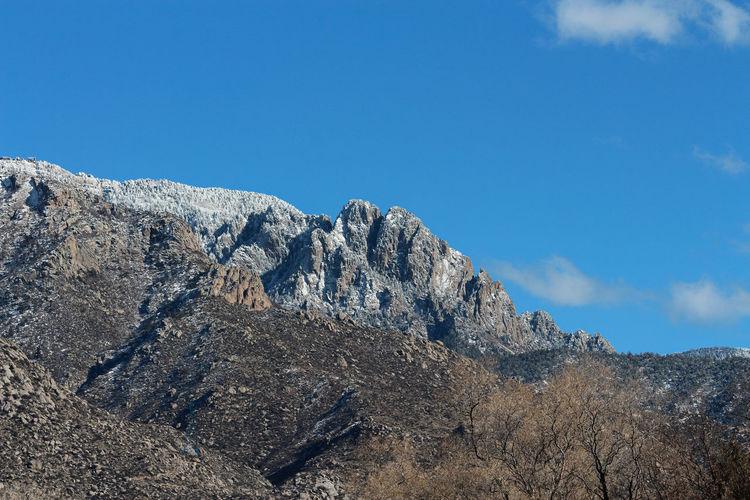 Scenic view of snowcapped mountain against sky. sandia mountains, albuquerque, new mexico