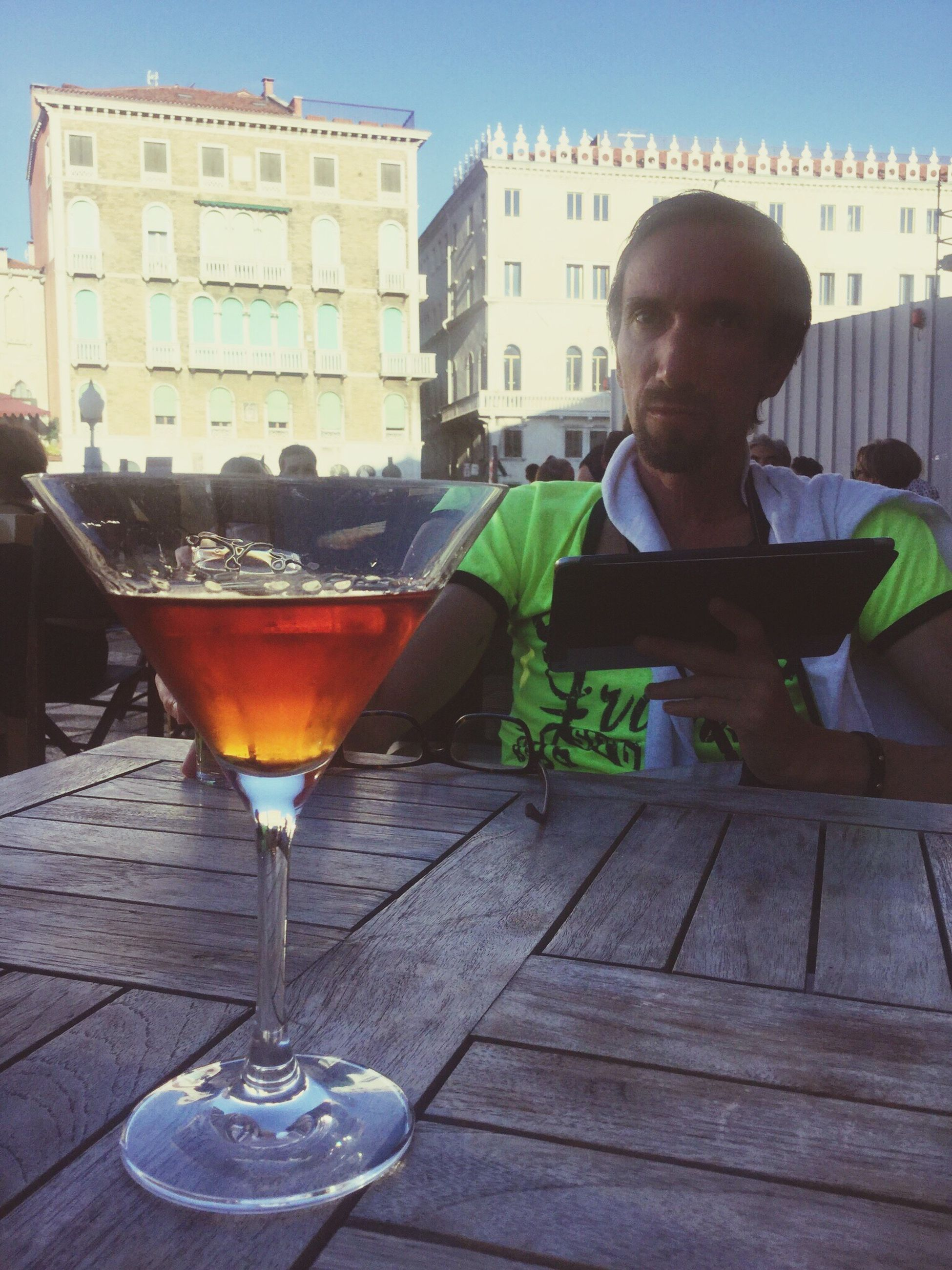 food and drink, city, architecture, city life, drink, building exterior, one person, cocktail, day, cityscape, freshness, people, martini glass, outdoors, adult