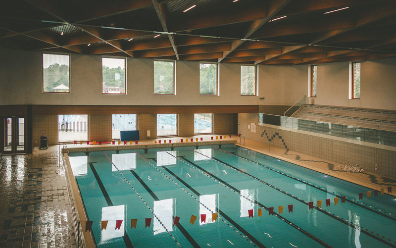 Empty swimming pool against building