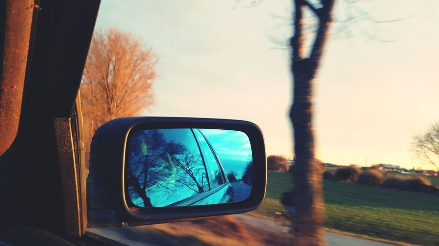 Tree Bare Tree Car Reflection Transportation Device Screen Side-view Mirror Day Mode Of Transport Sky Outdoors No People Nature Sunset Technology Close-up Digital Viewfinder Vehicle Mirror