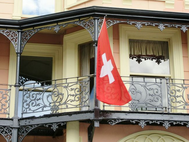 Seeing red in Kinsale, Ireland 3 Swiss Flag Red ColourHotel Balcony Wrought Iron Wrought Iron Design 19th Century Buildings Kinsale West Cork Wildatlanticway Ireland