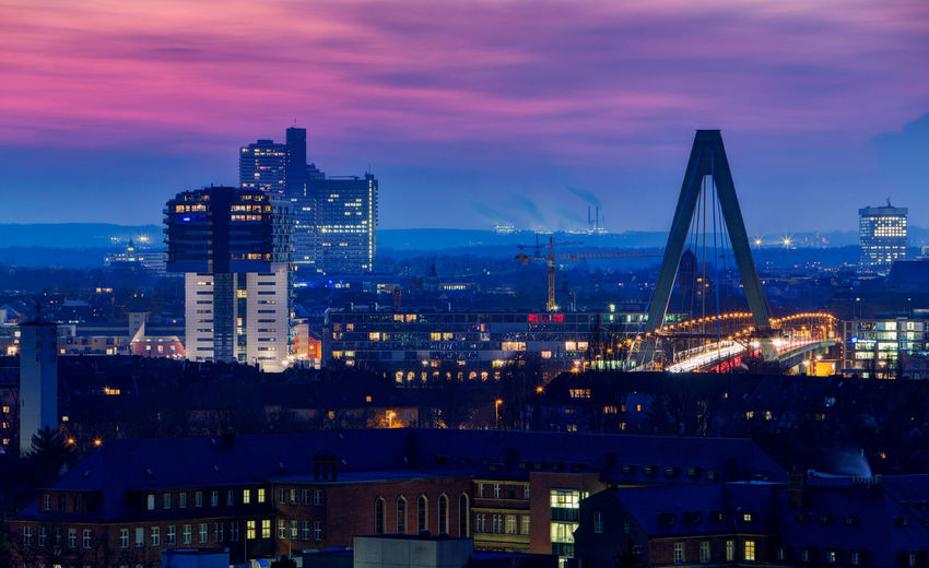 Cityscape of Cologne Cologne Cologne , Köln,  Cologne, Germany Architecture Building Building Exterior Built Structure City City Life Cityscape Cloud - Sky Dusk Illuminated Light Modern Nature Night No People Office Building Exterior Outdoors Sky Skyscraper Sunset Travel Destinations Water