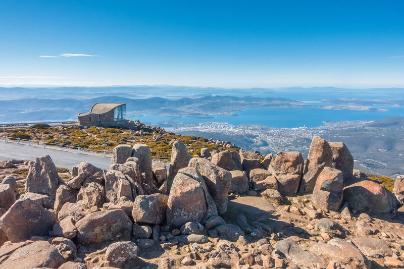 Scenic view at the summit of Kunanyi / Mount Wellington Observatory Architecture Bay Of Water Beauty In Nature Day Environment Land Mountain Mountain Peak Mountains And Sky Nature No People Outdoors Rock Rock - Object Rock Formation Scenics - Nature Sea Sky Solid Summit View Sunlight Tasmanian Landscape Tranquil Scene Tranquility