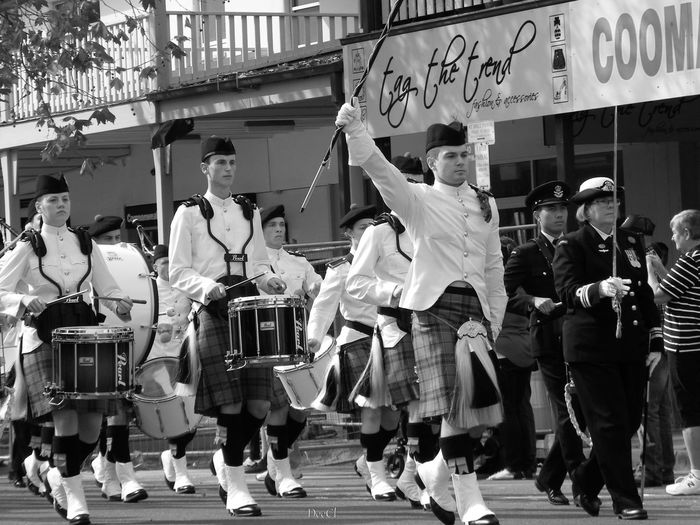 Streetphotography Blackandwhite Monochrome Full Length Coordination Performance Crowd Arts Culture And Entertainment Dancer Motion Dancing Women City Traditional Dancing Street Musician Walking Street Scene Marching Band Marching Drum Parade