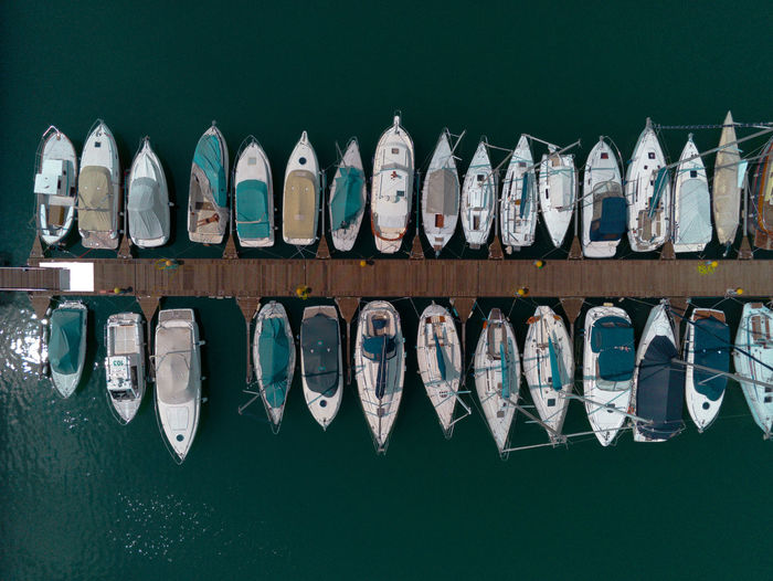 Row of boats moored in lake