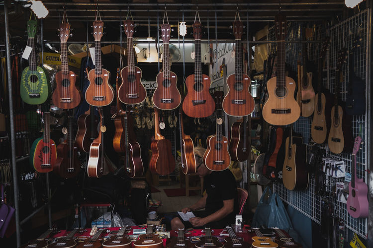 String instruments hanging in store