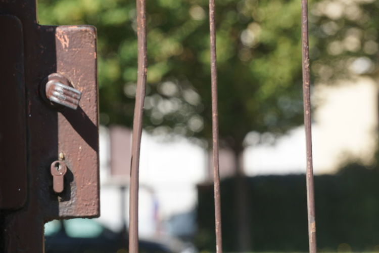 Close-up of rusty metal on the gate