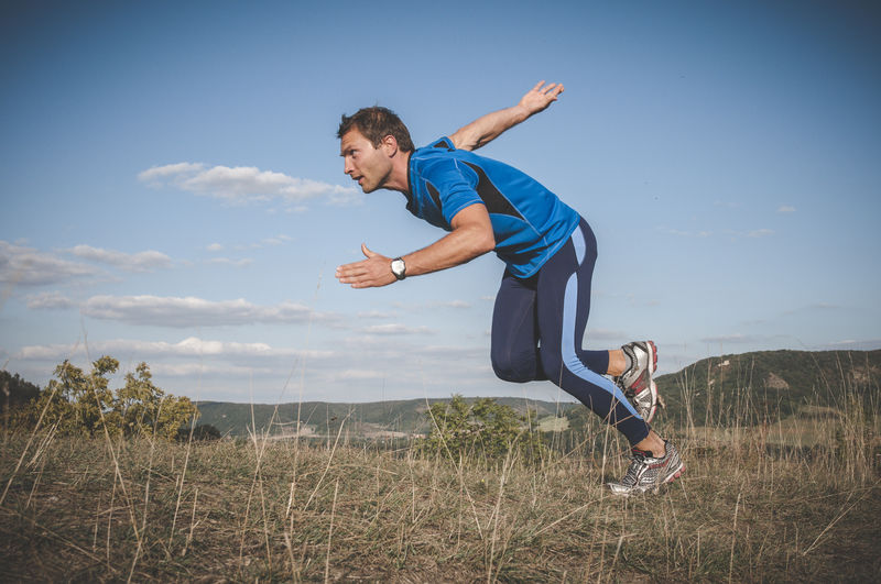 Man jogging Adult Man Running Day Exercising Fit Fitness Fitness Training Full Length Healthy Lifestyle Leisure Activity Lifestyles One Person Outdoors Real People Runner Sport Sports Clothing Start Success Vitality Young Adult Young Men