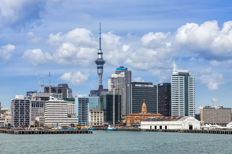 Skyline of Auckland, New Zealand. Architecture Auckland Bay Building Business City Cityscape Coastline Commercial Development District Dock Downtown Economy Exterior Finance Front View Futuristic Harbor Landmark Lookout Modern Nautical New Zealand Nobody North Island Oceania Office Outdoors Panorama Pier Quay Sea Sky Skyline Skyscraper Structure Tall Tower Town TOWNSCAPE Transportation Travel Destinations Urban Vessel Waitemata Water Waterfront Wealth Wharf Building Exterior Built Structure Cloud - Sky Office Building Exterior Tall - High Travel Day No People Spire  Financial District