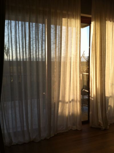 window treatment with nice sheer curtain. Curtain Window Drapes  Indoors  Day Home Interior Escape From Reality Wood Floor Warm Colors Brown Warm Light Minimalism Commercial Minimalist Still Life Freshness Morning Light Fabric Detail Window View Sheer Contemporary Vintage Interior Indoor Relax