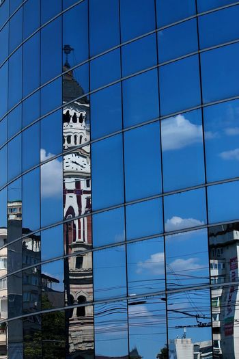 Architecture Built Structure Building Exterior Place Of Worship Architecture Built Structure Clock Tower Building Exterior Tower Blue Clock Sky Tall - High Outdoors Famous Place Bell Tower Day Sea Spire  Cloud - Sky Tall History Place Of Worship Romania Ploieşti