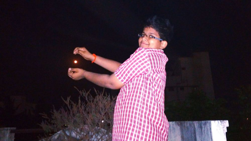 My brother trying to catch moon
