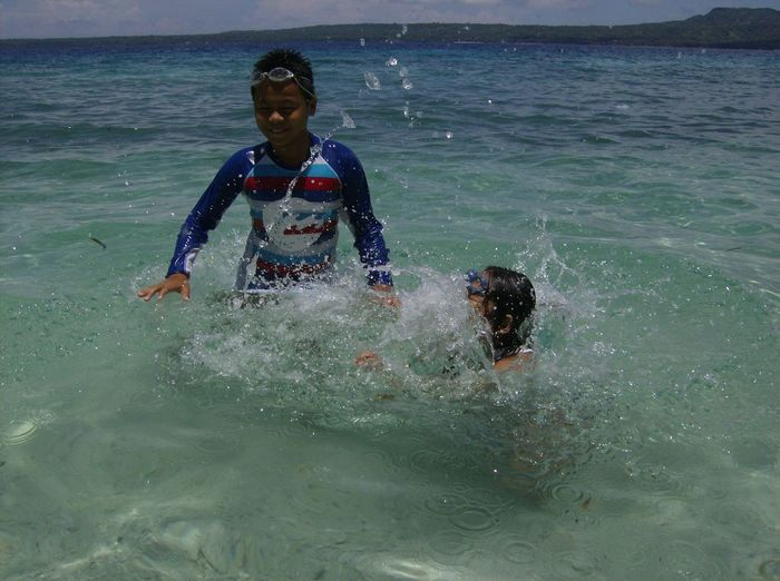 My babies enjoying swimming in the beach. Its weekend family day. We love going to the beach. This amazing clear blue water is located in Siquijor Province Philippines. This is Salagdoong Beach and Resort. EyeEmNewHere Sea Water Leisure Activity Lifestyles Real People Beach Nature Scuba Diving Waterfront Adventure Day Outdoors Young Adult Vacations Wave Splashing Waves, Ocean, Nature Ocean Waves Seaphoto Seaphotography Enjoying Life Waterfunday Childrenphoto Eduardocabo Connected By Travel