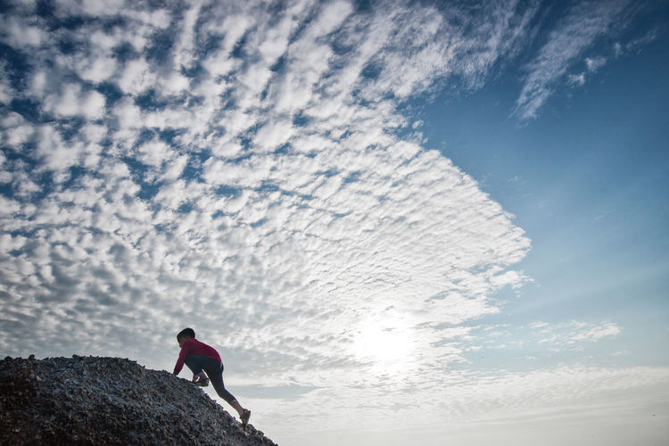Adventure Boy Climbing Climbing Cloud - Sky Extreme Sports Healthy Lifestyle Live For The Story Low Angle View Nature One Boy Outdoors Peak Sport The Great Outdoors - 2017 EyeEm Awards Place Of Heart