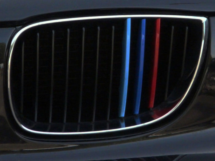 Bmw M Bmw TM Half Part Calender Close Up Chrome Contouring Black Polymer Color Touch Radiator Blue Red Black Colors Blue Red Features Motorsport Car Photography Close-up not a black detail