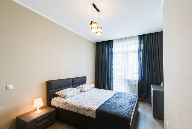 Furniture Indoors  Home Interior Domestic Room Home Showcase Interior Absence Bed Bedroom No People Home Lighting Equipment Window Luxury Modern Architecture Wall - Building Feature Wealth Building Illuminated Pillow Electric Lamp Ceiling