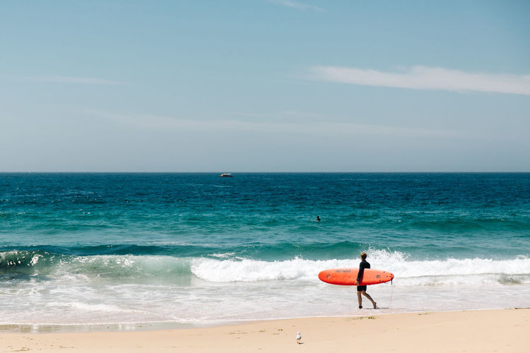 Sea Horizon Horizon Over Water Water Beach Land Sky Beauty In Nature Scenics - Nature Sport Wave One Person Aquatic Sport Surfing Real People Nature Leisure Activity Day Lifestyles Outdoors Travel People Portrait Outdoor Photography Streetphotography