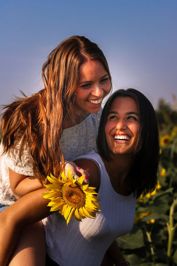 Smiling Young Women Against Blue Sky