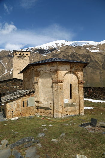 Architecture Sky Built Structure Building Building Exterior Mountain Day Nature No People Cloud - Sky Old Snow Cold Temperature Winter History The Past Outdoors Mountain Range Solid House Ruined Georgia Mestia/town In Svaneti/Georgia