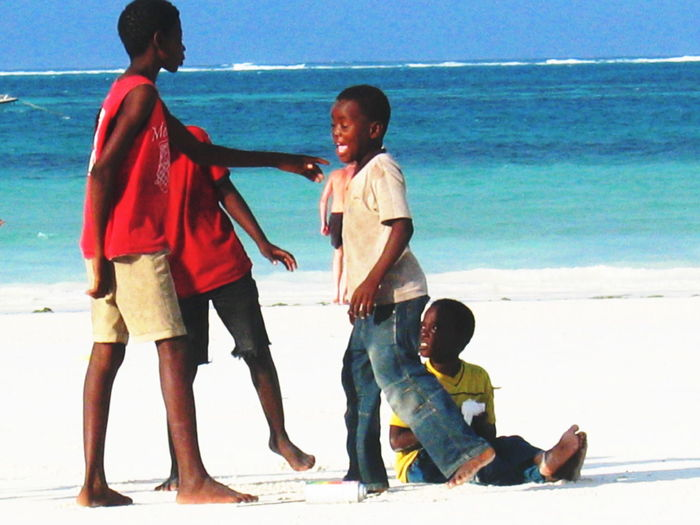 2006 Beach Blue Water Boys Childhood Colorful Day Dispute Leisure Activity Lifestyles Outdoors Real People Sea Sky Togetherness Water White Sand Zanzibar