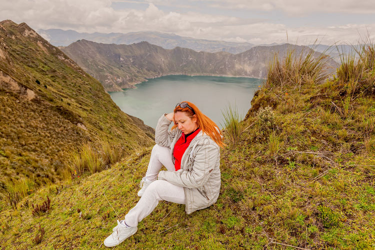 Beauty In Nature Casual Clothing Day Field Landscape Leisure Activity Lifestyles Mountain Mountain Range Nature One Person Outdoors Real People Redhead Relaxation Scenics South America Standing Tranquil Scene Tranquility Traveling Water Women Young Adult Young Women
