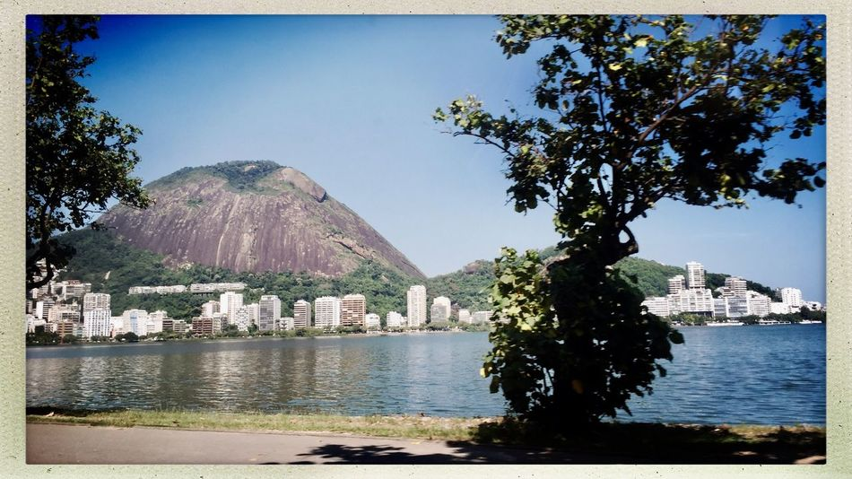 My city is beautiful Hipstography Hipstamatic My City Is Beautiful Water Tree Built Structure Architecture Building Exterior No People Day Outdoors Mountain Sky