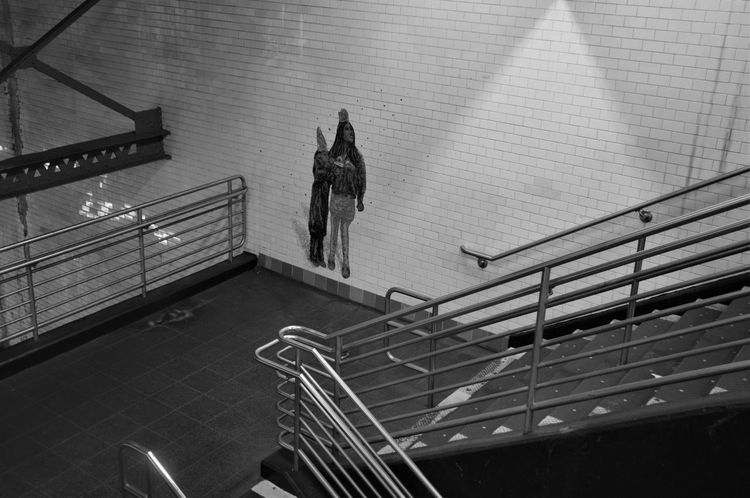 Moment from Manhattan Empty Places Fear The Street Photographer - 2018 EyeEm Awards Figures On Wall High Angle View Metal No People Railing Shadowy Staircase Subway Station