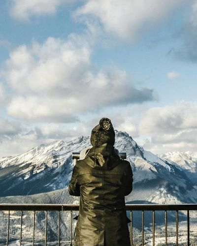Beauty In Nature Cloud - Sky Cold Temperature Day Mountain Mountain Range Nature No People Outdoors Railing Scenics Sky Snow Snowcapped Mountain Standing Statue Warm Clothing Weather Winter