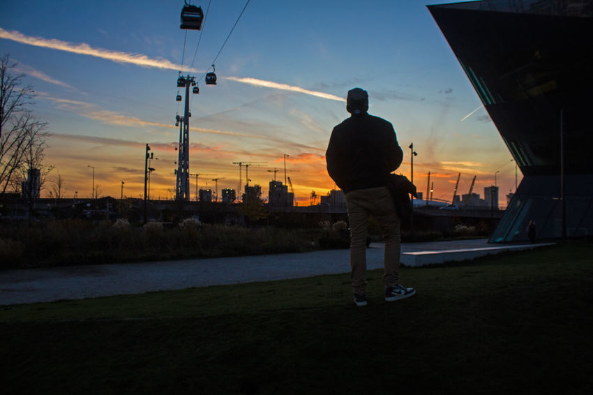 Beautiful Sky And Clouds Adult Architecture Building Exterior Built Structure City Day Full Length Leisure Activity Lifestyles Men Nature Nike One Person Outdoors People Real People Rear View Silhouette Sky Snapback Standing Sun Sunset