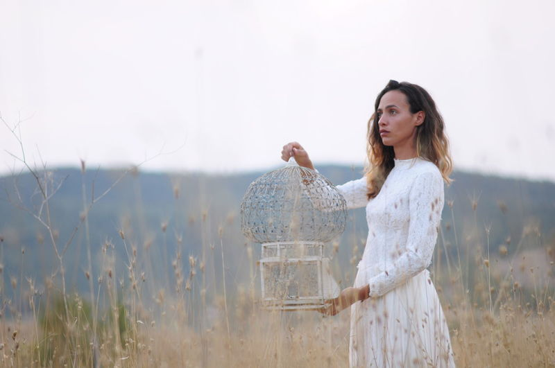 gessica with bird cage Dream EyeEm Best Shots Fairytale  Fairytales & Dreams Freedom Italia Summertime Adult Beautiful Woman Beauty Beauty In Nature Bird Cage Day Evening One Person Outdoors People Poetry Real People Summer Tranquil Scene Wedding Dress Women Young Adult Young Women