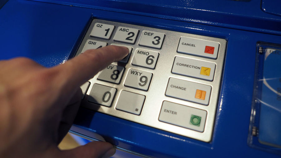 Blue color banking ATM machine and black number on white button keypad. Button Atm Atm; Machine; Money; Code; Keypad; Bank; Pin; Banking; Close; Finance; Cash; Closeup; Up; Card; Deposit; Technology; Number; Financial; Electronic; Key; Password; Business; Hand; Computer; Button; Debit; Currency; Enter; Automated; Withdraw; Security; Tel Blue Close-up Day Indoors  Number Technology
