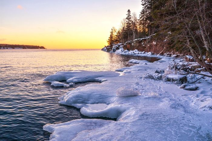 Burlington Bay in Two Harbors, Minnesota Sunrise_Collection Sunrise_sunsets_aroundworld Sunrise Lake Superior Streamzoofamily Malephotographerofthemonth Beauty In Nature Nature Water Cold Temperature Scenics Ice Sky No People Tranquility Tranquil Scene Frozen Winter Snow Outdoors