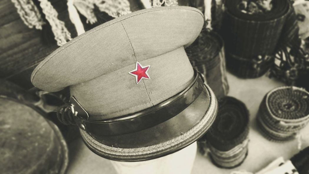 Hat Old Hat Old Army Hat Black And White Monochromatic Outdoors No People Up Close High Angle View Objects Antique Shop Old Stuff Light And Shadow Out And About EyeEm Best Shots Open Edits Photography Taking Photos Feeling Creative Street Photography Red Star Star Travelling Outdoor Photography Albania