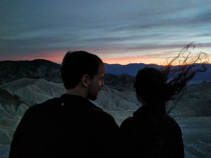 Death Valley National Park California Sunset Dusk Outdoors Landscape People Relationships Scenic Places Scenics Couple Togetherness Romance Bonding Active Lifestyle  Activewear Sky Evening Light Silhouette Wind Blown Hair Nature View From Behind Overlook