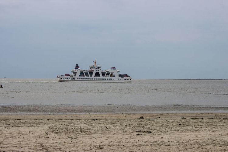 Ferry Frisia Frisia IV Fähre Meer Ostfriesland Strand Day Küste No People Nordsee Outdoors Sand Sky Tourism Travel Travel Destinations