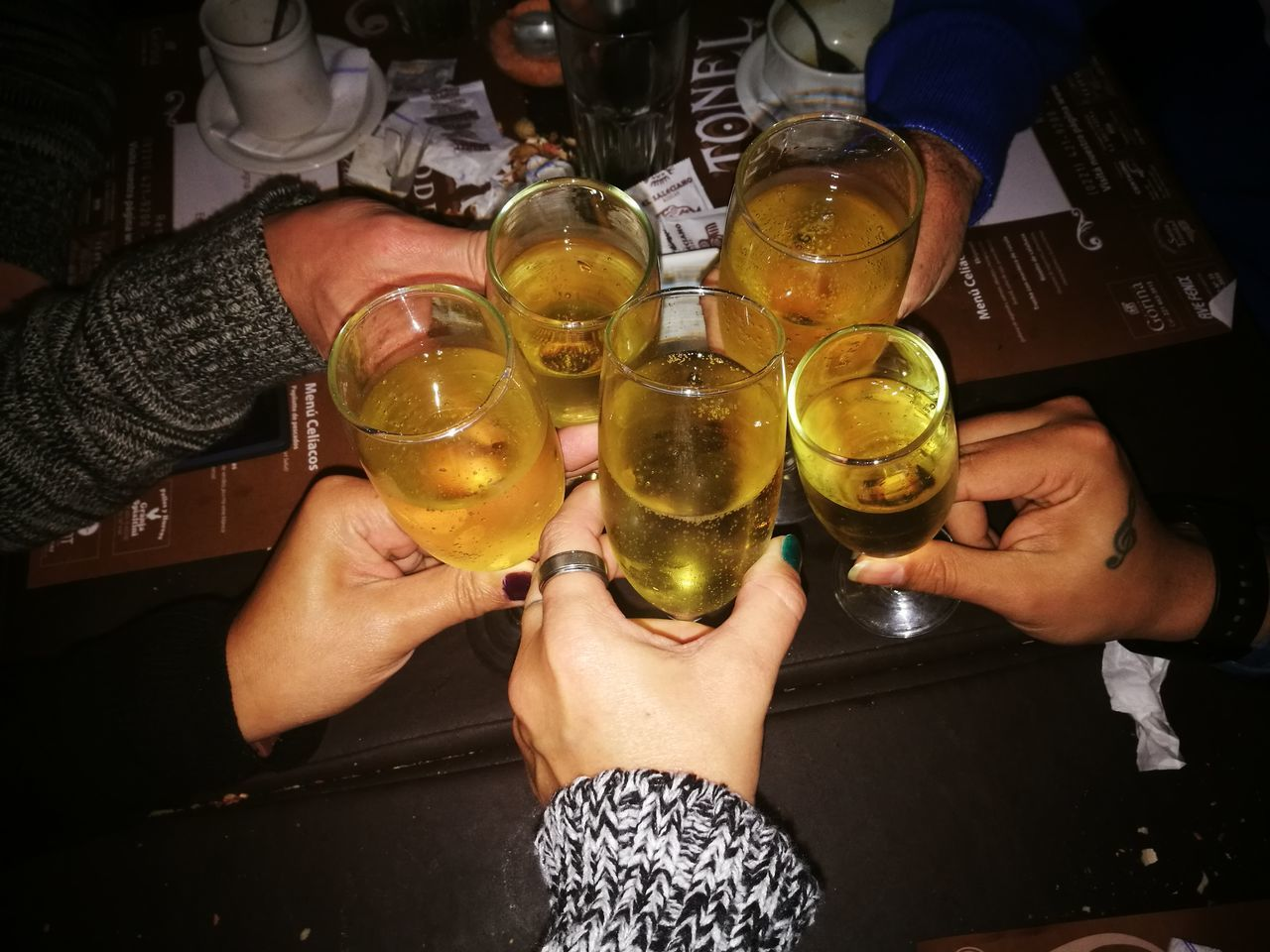 real people, human hand, human body part, food and drink, holding, lifestyles, leisure activity, men, drink, alcohol, women, refreshment, friendship, high angle view, indoors, celebration, togetherness, two people, freshness, low section, happy hour, day, adult, people