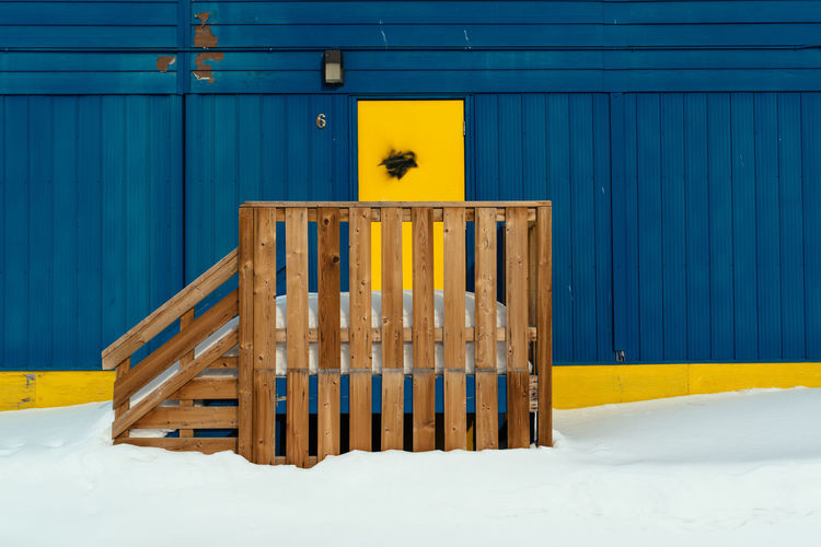 Yellow umbrella on wood during winter
