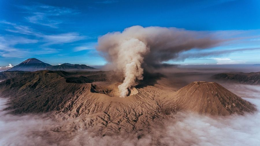 SCENIC VIEW OF SMOKING VOLCANO