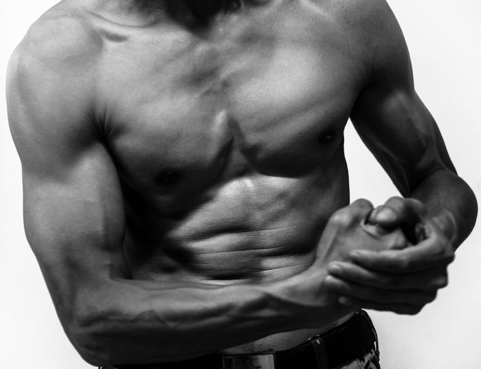 The beauty of the power Abdomen Close-up Day Human Body Part Human Hand Indoors  Macho Masculinity Men Midsection Muscular Build One Person People Real People Shirtless Standing Strength White Background