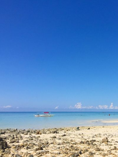 Sea Blue Water Horizon Over Water Clear Sky Beauty In Nature Nature Beach Scenics Outdoors Day Sky Tropical Climate Tourism Travel Destinations Cloud - Sky Sand Scenery