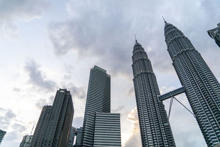 Sunset at Petronas Twin Towers KLCC, Kuala Lumpur Architecture Built Structure Building Exterior City Building Office Building Exterior Skyscraper Sky Low Angle View Cloud - Sky Tall - High Modern Tower Office Nature Travel Destinations Day No People Landscape Outdoors Financial District  Cityscape Spire