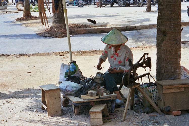 Street handworker on Hainan island, China China China Photos Hainan Hainanisland Handwork Handworker Lifestyles One Person Outdoors Sewing Machine Sewing Stuff Shoe Repair Working Hard