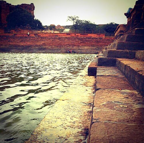 The Architect - 2016 EyeEm Awards Indian Architecture Historical Badami Karnataka Rural Stepwell Water Water Surface Ripples Stone Temple Architecture Peaceful Settlement Time Age Monument Traveldiaries Summertime
