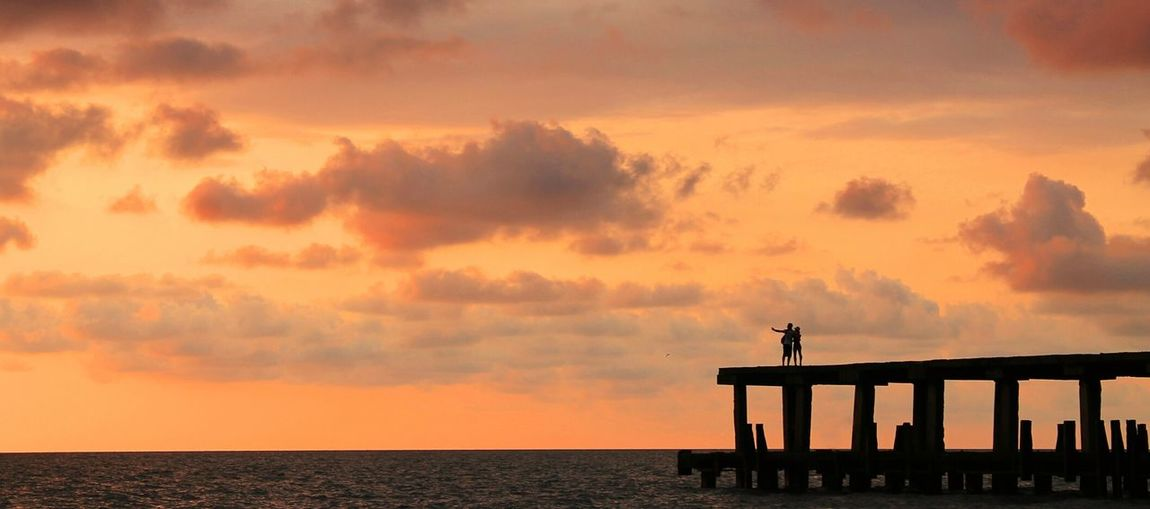 A couple taking selfie. Taking Photos The Minimals Sunset Silhouettes Sunsets Sky Sky And Clouds Romance Couple Summer2015 Summer Views Adventure Buddies Landscapes With WhiteWall The Great Outdoors - 2016 EyeEm Awards