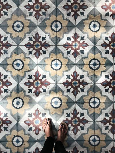 India Sunlight Amritsar Body Part Design Directly Above Flooring Floral Pattern Human Body Part Human Foot Human Limb Leisure Activity Lifestyles Low Section One Person Pattern Personal Perspective Real People Shape Standing Tile Tiled Floor