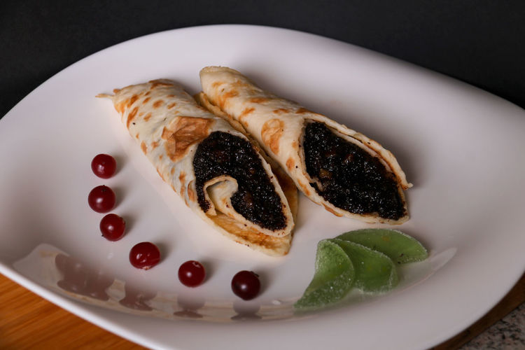 Pancakes with poppy seeds Close-up Cranberry Crêpes Food Food And Drink Freshness Healthy Eating Indoors  No People Pancakes Pancakes Day Plate Portion Ready-to-eat Sweet Dish  Sweet Food Breakfast